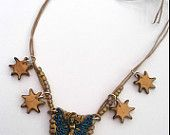 Starry fairy necklace, gold and blue, brass and enamel fairy on gold shield, Titania fairy necklace, gold stars, unique clay design, unusual