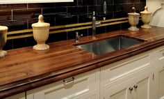 2-1/2 inch Walnut with Sapwood Countertop in brown color with a Large Bead and Cove edge profile and a Durata Finish. Special feature is an Undermount Sink. Designed by Vincent Cappello, Putnam Kitchens. https://www.glumber.com/