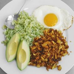 ... olive oil herb rice, avocado slices and a fried egg. Gluten-free