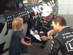 Jimmie Johnson, Evie, and Chad Knauss plan some last minute strategy.