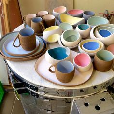 Candy colours ready to be glazed and re-fired #ceramics #stoneware #pottery #pebbles #mugs #platters #multicolor #oneofakind #myrtozirini #corfu #greekislands