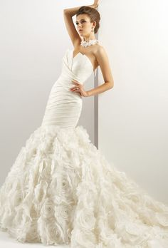 Brides: Jasmine Couture . Strapless crumb-catcher neckline with asymmetrical waist and full beaded flower skirt.