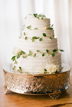 Brides.com: . For her cousin's wedding in Seattle, Canadian pastry chef Christina McKenzie of The Cocoa Cakery baked the cake layers at home (the flavors: chocolate, vanilla, red velvet, and Aunt Harriet's carrot cake — how sweet is that?) and brought them onto the plane as her carry-on. She assembled and decorated the cake the morning of the wedding, frosting the buttercream and adding fresh flowers and greenery to create this dreamy dessert. $5.50 per slice, The Cocoa Cakery