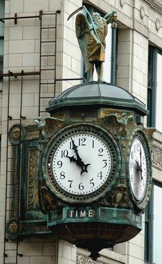 Father Time ~ Ornamental clock on the building at 35 East Wacker Drive in Chicago, Illinois., 2006.