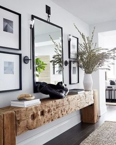 Talk about making an entrance! I love everything about this amazing entryway—the symmetry, the gorgeous textures, and that fabulous reclaimed wood console table! What's your favorite feature? Modern Decor, Apartment, Interior Design Trends, House Design, Cozy House, Trending Decor, Home Decor, House Interior, Home And Family