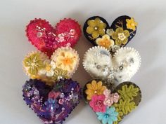 Embroidered and needle felted hearts by Cindy Sunshine
