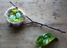 Stitched stone eggs in a wool nest by Lisa Jordan of lil fish studios