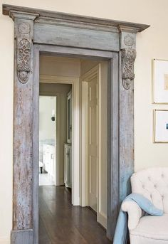 The antique door surround with corbels and blue/gray paint finish.