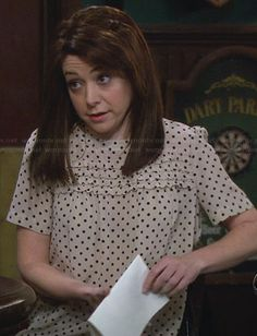 Lily's polka dot ruffled front top on How I Met Your Mother.  Outfit Details: http://wornontv.net/28819/ #HIMYM