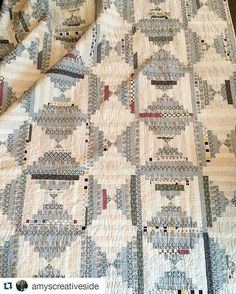 Lovely log cabin quilt......shades of grey