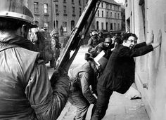 John Hume is detained by soldiers during a civil rights protest in #Derry in August 1971.