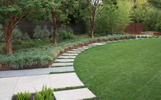 path with large format pavers used to define the lawn area