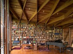 """We found this on a great site called """"Bookshelf Porn"""" - and for anyone who loves books as much as us, you know what it means to be addicted to books. We really love the unique space, the crossed-beams and angles on the ceiling reflected into the bookshelf. Fantastic!"""
