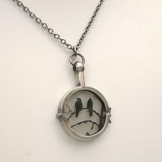 Raven Necklace.  Sterling Silver Handmade Locket.  Nevermore. $300.00, via Etsy.