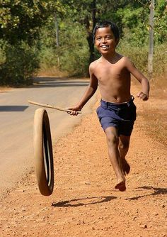 A young boy having fun in Goa, India.