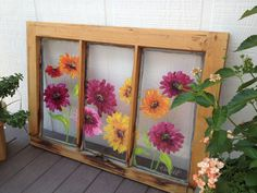 Painted window with zinnias