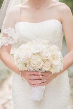 White Rose Bouquet   On Style Me Pretty: http://www.StyleMePretty.com/canada-weddings/2014/03/07/elegant-neutrals-niagara-wedding/ SBP Photography