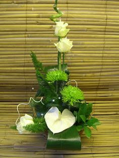 green and white floral arrangement. tropical