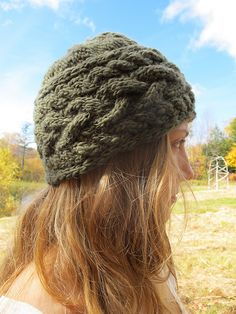 I made one of these.  It is knit sideways and even though I added several stitches, it did not cover.  It come down far enough on my ears to suit.  Ultimately, I frogged.  But it was very pretty, before I ripped it apart.  Ladies with tiny heads: this is for you!