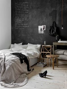 Paint the whole wall behind the bed with black chalk board paint makes a great versatile bed head