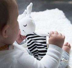Sweet bunny from Wee Gallery, made for cuddling. Its high contrast patterns, taggy hands & feet make it an easy comforter for baby to love right from day one. Little Babies, Little Ones, Sheep Fabric, Baby Sense, Bunny Face, Baby Grows, Newborn Gifts, Black Stripes, Baby Love