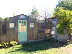 Everyone who visits now wants to take a picture in front of this wall.I was just trying to hide the propane tank. Propane Tank Cover, Propane Tanks, Cabin Decks, Run In Shed, Ponds Backyard, Backyard Ideas, Rustic Outdoor, Outdoor Ideas, Garden Doors