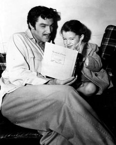 Daddies and Daughters: On set of 'The Pirate' Gene Kelly reads to his little girl, Kerry. Precious!!