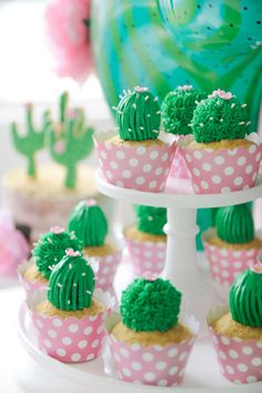 Prickly cactus birthday party cupcakes. Bright green frosting, white sprinkles, and mini pink edible flower. White and pink scalloped polka dot cupcake cases. Cactus Party styling by Happy Wish Company. Photography by Tammy Hughes Photography. Stationery by Minted artist, Baumbirdy.