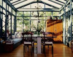 Sunroom Decorating and Design Ideas. Get inspired with clever layout and pretty fabrics, furniture, and accents to transform your sunroom into the most-used room in your house. Tags: sunroom design ideas, sunroom furniture, floor to ceiling windows Greenhouse Apartments, Loft Apartments, Beautiful Space, Beautiful Homes, Orangerie Extension, Living Haus, City Living, Glass Room, Glass Walls