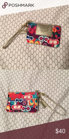 Coach Poppy Wristlet The gold patch is in the front. Barely used, like new.  Very colorful and bright. Coach Bags Clutches & Wristlets