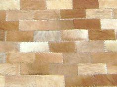 Teppe m/ rektangulære skinn elementer