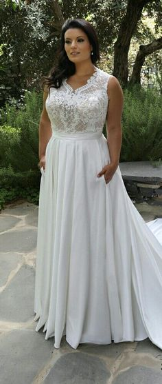 a7e527a5b44 Plus size fashionable wedding dress with lace bodice and satin skirt with  pockets and long train