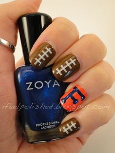 I would never do this myself.. but pretty cool!! (maybe blue nails with just one orange F on the ring finger!)