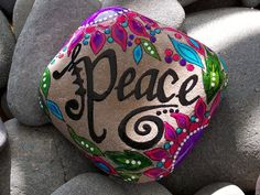 Peace word-painted rock