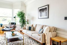 """The home is an eclectic mix of old and new. For example, the floor lamp is a find from the Alameda Flea, but the sofa is brand new from <a href=""""http://www.dwr.com/living-sofa-and-sleepers/raleigh-sofa/7035.html?lang=en_US#lang=en_US&start=18"""" target=""""_blank"""">DWR</a>."""