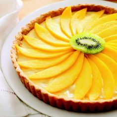This tart takes a tropical turn with its lime pastry cream and sliced mango and kiwi.