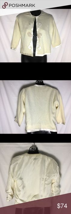 """Made in Japan lambswool satin edged cardigan Very nice lined lambswool angora nylon cardigan. Small to x Small. Bust laid fflat armpit to armpit 19 inches sleeves 3/4 style from shoulder seem 15.5"""". Length 20"""". Color is an ivory off white made in Japan Sweaters Cardigans"""