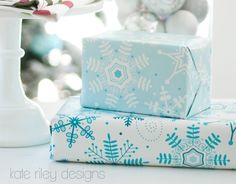 Great designs! Love the bold patterns & coordinating colors of these gift wrapping papers (snowflake). By kateriley at Spoonflower. (Matching fabrics available.)