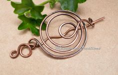 Make your hair looks unique and beautiful style. Antique Copper Spiral bun cage ,for long or thick hair . Hammered on copper swirled gives the piece strength to maintain its shape.  There are four sizes of hair bun slides. Extra large 4-----stick is 5in length. Large is 3.8 -----------stick is 4.5 in length . Medium is 3.5-------stick is 4.2 in length . Small is 3.2 ----------stick is 3.6 in length .  The solid copper used in its natural form treated with a wax  Basic Shipping: Packages are…