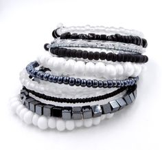 This simple yet stunning 10 row black and silver memory wire wrap bracelet is made with an assortment of glass Czech beads in sizes ranging from tiny 11/0 seed beads up to large 32/0 & 34/0 potato seed beads, small silverlined bugle beads, Hematite cube beads, and twisted glass bugle beads for a layered stacked look that will be sure to get you compliments on this adorable arm candy! **Read my FAQs below and if you have any further questions or comments please do not hes...