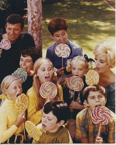 The Brady Bunch 8x10 publicity photo the cast all holding lollypops