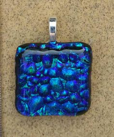 Check out this item in my Etsy shop https://www.etsy.com/listing/466389177/fused-glass-jewelry-pendant-dichroic
