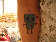 get a robot tattoo? (ps mine would be two robots in love)