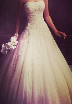 love the top of the dress and how the flowers run intot he bottom of the a line skirt. stunning, classic yet elegantly fun. wedding dress wedding dresses