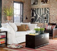 Love the exposed brick wall and number painting.. very New York Loft.