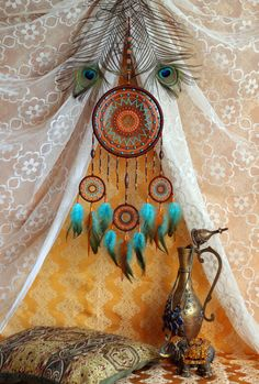 Detailed dreamcatcher is made in the style of boho. It combines four different colours: brown, orange, turquoise, green. I used only natural