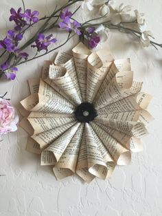 A Unique and Beautiful Rustic French Book Paper Cone Wreath, Naturally Aged pages from the play by Moliere, Le Bourgeois Gentil Homme, originally written in the 17th century, the copy I used was published in 1933. Written as a combined comedy and ballet, George Ballanchine created a special ballet for Rudolph Nureyev from this work  Adorned with an organza rose and rhinestone jeweled center. Also dusted with a sparkle of German Glitter Glass.  Approx. 11 diameter; with satin ribbon for…