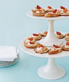 To cut down on waiting time for hors d'oeuvres, stack a small cake stand on top of a larger one to increase your surface area for canapés or crudités and free up precious table space.