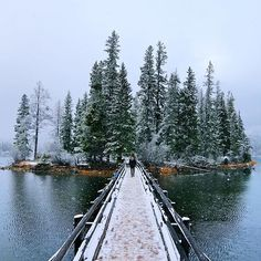 A bridge to a winter wonderland. Tag someone who loves the snow!  Photo of Spirit Island on Maligne Lake in Jasper National Park under the snow by #MatadorN reader @steverobert1. Thanks for tagging #travelstoke!