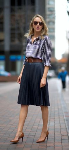 Navy pleated midi skirt + striped shirt + cognac accents --I could probably pull off this exact look at some point in my career. Just need to work on my comfort level with heels and skirts... This length looks perfect.